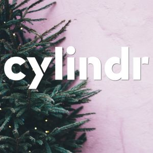 cylindr logo on top of a Christmas tree on a pink background